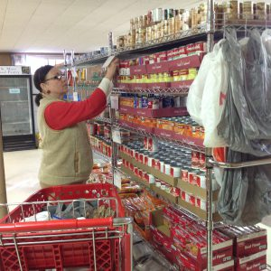Filling the shelves at St. Mary